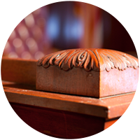 Photo Of Wooden Detail In A Courtroom - Litigation Insights